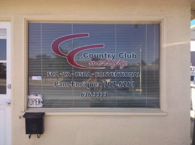 Red & black lettering with white outline on window with blinds